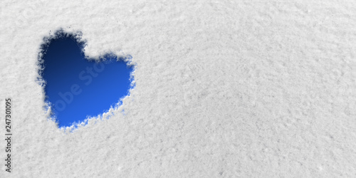 Photo  Blue Heart in front of Snow Background