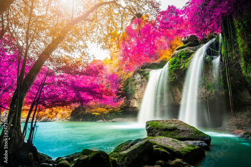 fototapeta na lodówkę Amazing in nature, beautiful waterfall at colorful autumn forest in fall season