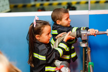 Little Boy And Girl In Fireman...