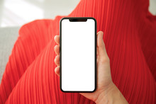 Female Hands In Red Dress Holding Phone With An Isolated Screen