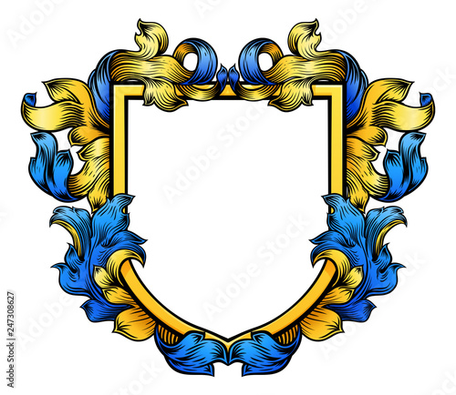Fototapeta A coat of arms crest heraldic medieval knight or royal family shield. Blue and yellow vintage motif with filigree leaf heraldry. obraz