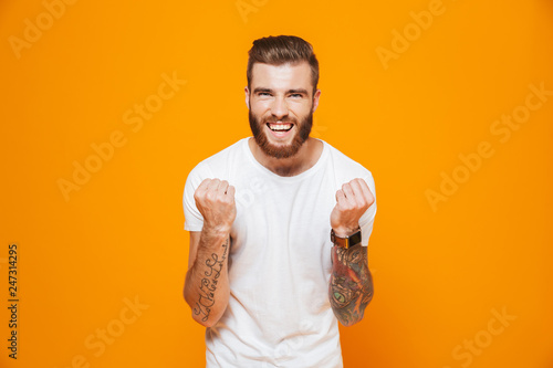 Portrait of a cheerful young man wearing casual clothes Wallpaper Mural
