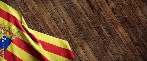 Photo Bandera de Aragón sobre fondo de madera