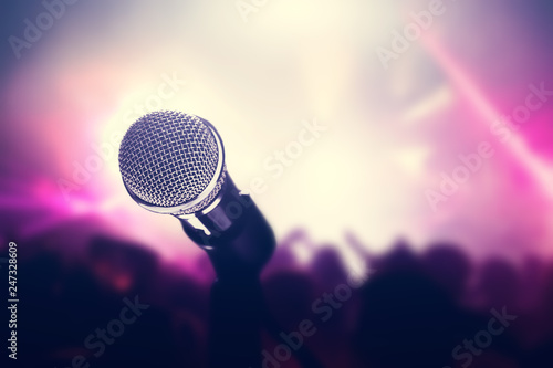 Microphone on stage, crowd of people in the club. Canvas Print