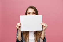 Young Caucasian Woman Holding Blank Paper Sheet Over Isolated Background Scared In Shock With A Surprise Face, Afraid And Excited With Fear Expression