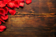 Romantic Happy Valentines Day Greeting Card, Wedding Invitation Concept. Frame Made Of Red, Scarlet, Crimson Rose Petals On Dark Wooden Floor. Close Up, Top View, Copy Space, Mock Up, Background.
