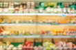 blur background of fresh food in supermarket shelf with bokeh light.grocery product on shelves.