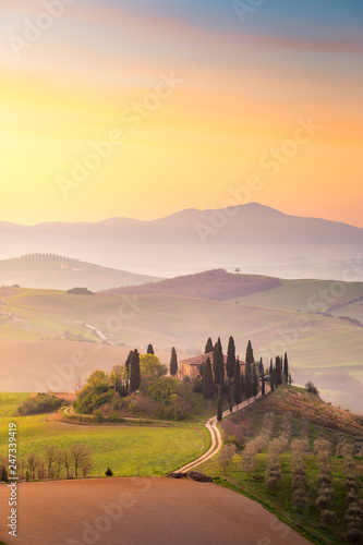 Printed kitchen splashbacks Beige A Farmhouse near San Quirico d'Orcia with green hills and cypresses.