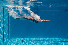 Woman Diving In Swimming Pool