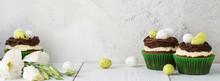 Easter Chocolate Cupcakes Decorated With Nest And Candy Eggs