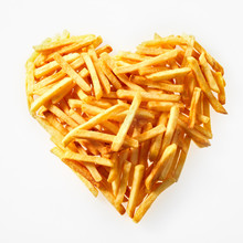 Close-up Of Salty French Fries In Heart Shape