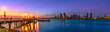canvas print picture - Panorama of Coronado old pier reflecting on in San Diego Bay from Coronado Island, California, USA. San Diego cityscape skyline with Downtown and Waterfront Marina District at twilight on background.