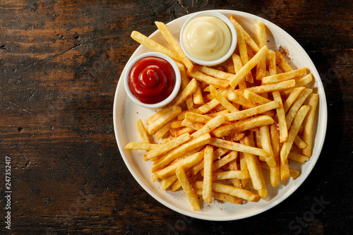 Fototapeta Plate of french fries with sauces with copy space obraz