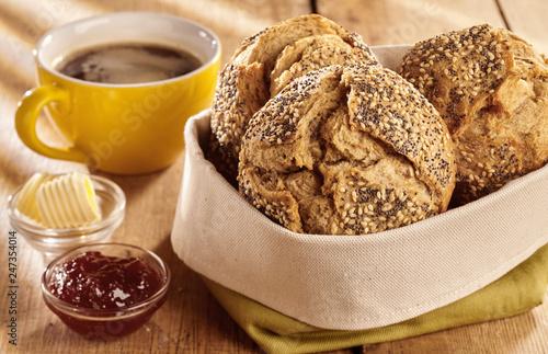 Fototapeta Fresh baked buns of bread served for breakfast obraz