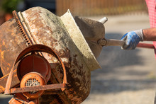 Construction Site Work With Concrete Mixer And Wheelbarrows