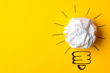 Concept Creative Idea. Concept Of Creative Idea. Crumpled Paper Balls And Painted Light Bulb On Bright Background. Metaphor, Inspiration.