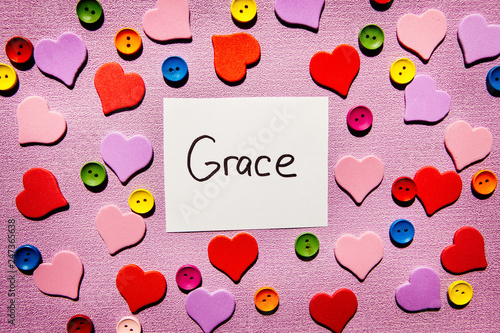 Fotografie, Obraz  Grace - word on colorful pink background with hearts decorations, religion and m