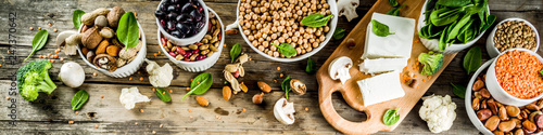 Fotografia Healthy plant vegan food, veggie protein sources: Tofu, vegan milk, beans, lentils, nuts, soy milk, spinach and seeds