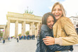 canvas print picture Happy girls meeting and embracing in Berlin