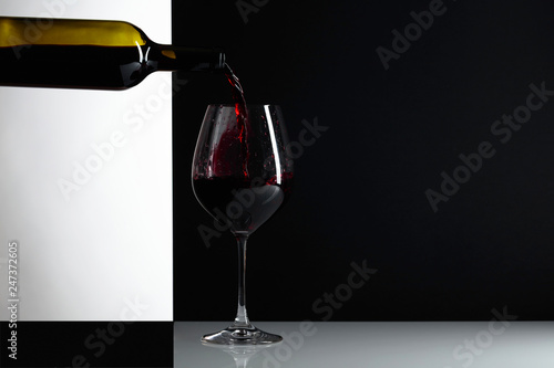 Red wine is poured into a glass.