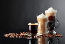 Various Coffee Drinks On A Bla...