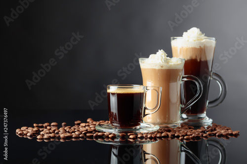 Fotografia Various coffee drinks on a black background.