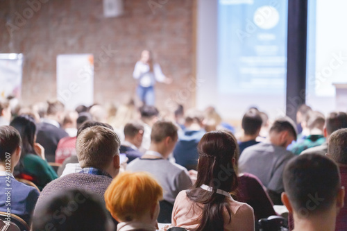 Fotografia Adult students listen to professor's lecture in class room, hands up for queue of asking question to Lecturer or poll voting