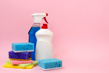 Detergent Spray Bottle Standing Near Cleaning Soap And Sponges