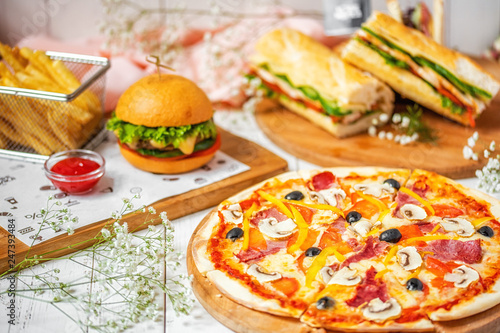 delicious lunch, pizza, hamburger, sandwich and french fries © Artem Orlyanskiy