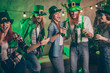 Group funky funny company raise beverage wear specs irish culture costumes tradition hats laugh laughter dancing drunk messy scream shout national song singer singing glad couples best friends