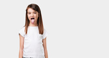 Full Body Little Girl Expression Of Confidence And Emotion, Fun And Friendly, Showing Tongue As A Sign Of Play Or Fun