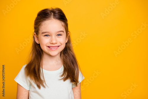Portrait of her she nice-looking cute winsome sweet attractive lovely pretty cheerful cheery positive caucasian pre-teen girl isolated over bright vivid shine yellow background
