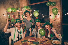 Close Up Photo Lucky Tradition Culture Celebrating Company Together St Paddy Day Mood Green Leprechaun Hats Glad Table Full Of Food Eat Tell Speak Talk Toasts Meet New Guests Decorated Flat Apartments