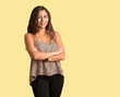 canvas print picture - Full body young curvy plus size woman crossing arms, smiling and relaxed