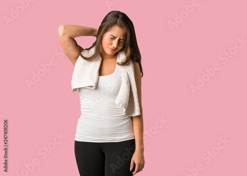 Full body young fitness curvy woman suffering neck pain Wallpaper Mural