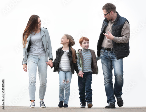 parents discussing that the with their children during walk