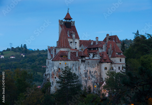 Fotobehang Europa Bran Castle on cliff top on twilight