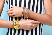 Female Hands With Bracelets And Rings
