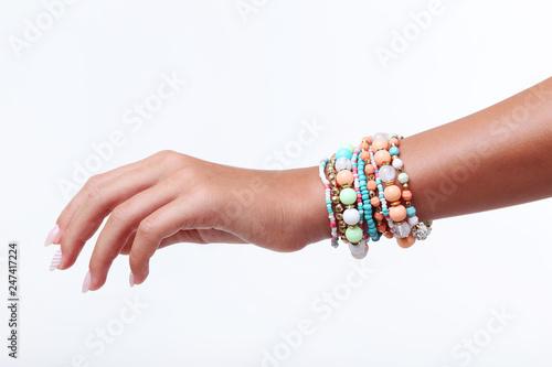 Obraz na plátně Female hand with bracelets on white background