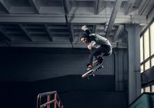 Skateboarder Jumping High On M...