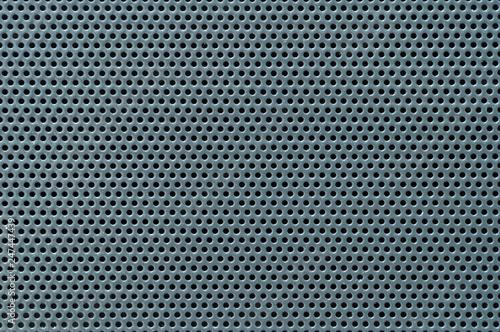 Valokuvatapetti Surface texture of perforated metal sheet, macro.