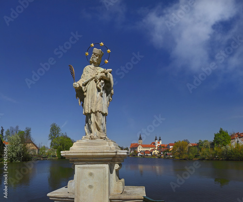 In de dag Historisch mon. Baroque marble statue of St.. John of Nepomuk and the panorama of the town Telc. Czech Republic, World Heritage Site by UNESCO