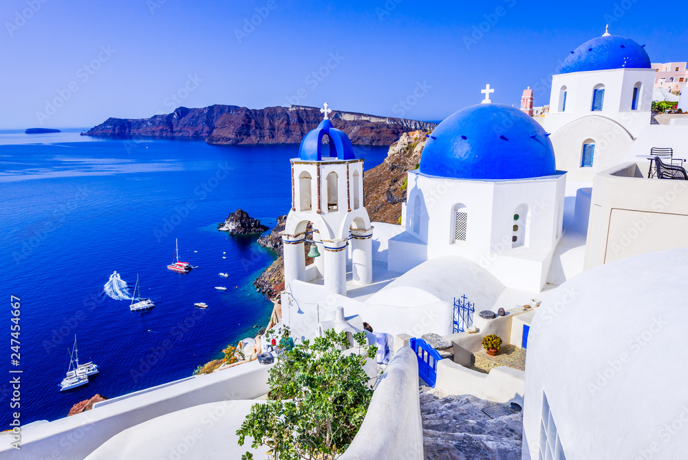 Fototapeta Oia, Santorini, Greece - Blue church and caldera