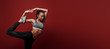 Sport is my religion. Sportswoman standing over red background, stretching her body