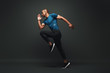 Leinwanddruck Bild - Deserve Victory. Sportsman jumping over dark background, he is ready to run