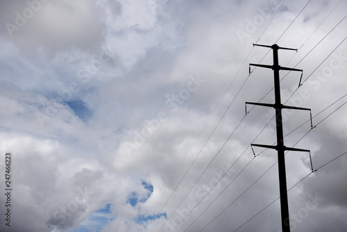 Fotografie, Obraz  Tall steel electricity pylon, high voltage power lines, stormy cloudy sky in northern Texas, USA