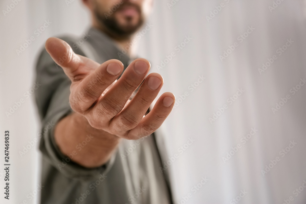 Fototapeta Man giving hand to somebody, closeup with space for text. Help and support concept