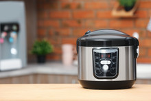 Modern Electric Multi Cooker On Table In Kitchen. Space For Text