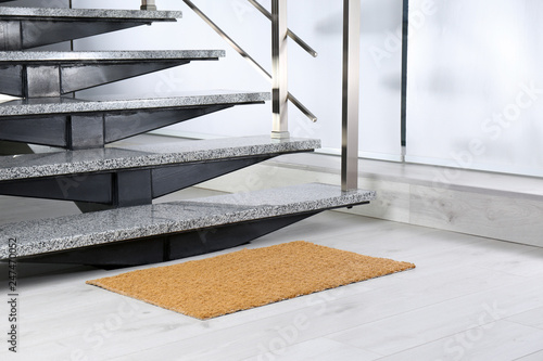 Papiers peints Escalier New door mat near stone stairs indoors