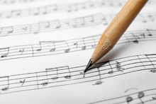 Sheet With Music Notes And Pencil As Background, Closeup